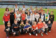 21 June 2011; Ulster Bank GAA stars Craig Dias, Rory O'Carroll, Karl Lacey, pictured with pupils, from St.Patrick's Primary School, Armagh, at Croke Park as part of the Ulster Bank/Irish News competition where five lucky classes won a school trip of a lifetime which included a tour of the famous Croke Park Stadium while also meeting some of the biggest GAA stars in the country. Croke Park, Dublin. Picture credit: David Maher / SPORTSFILE