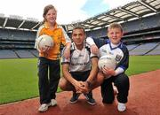 21 June 2011; Ulster Bank GAA star Craig Dias with Sarah Nugent and John Joe Hunter, both pupils, from St.Patrick's Primary School, Armagh, in Croke Park as part of the Ulster Bank/Irish News competition where five lucky classes won a school trip of a lifetime which included a tour of the famous Croke Park Stadium while also meeting some of the biggest GAA stars in the country. Croke Park, Dublin. Picture credit: David Maher / SPORTSFILE