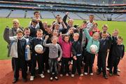 21 June 2011; Ulster Bank GAA stars Craig Dias, Rory O'Carroll, Karl Lacey, pictured welcoming pupils, from St. Brigid's Primary School, Omagh, Co.Tyrone, to Croke Park as part of the Ulster Bank/Irish News competition where five lucky classes won a school trip of a lifetime which included a tour of the famous Croke Park Stadium while also meeting some of the biggest GAA stars in the country. Croke Park, Dublin. Picture credit: David Maher / SPORTSFILE