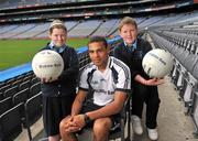 21 June 2011; Ulster Bank GAA star Craig Dias with Emma Haughey and Tiarnan Begley, both pupils from St. Brigid's Primary School, Omagh, Co. Tyrone, as part of the Ulster Bank/Irish News competition where five lucky classes won a school trip of a lifetime which included a tour of the famous Croke Park Stadium while also meeting some of the biggest GAA stars in the country. Croke Park, Dublin. Picture credit: David Maher / SPORTSFILE