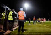 25 January 2017; Stewards look on as Aaron Shanagher of Clare takes on David Griffin of Cork during the Co-Op Superstores Munster Senior Hurling League Round 5 match between Clare and Cork at O'Garney Park in Sixmilebridge, Co Clare. Photo by Diarmuid Greene/Sportsfile
