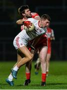 28 January 2017; Padraig McNulty of Tyrone in action against Mark Lynch of Derry during the Bank of Ireland Dr. McKenna Cup Final match between Tyrone and Derry at Pairc Esler in Newry, Co. Down. Photo by Oliver McVeigh/Sportsfile
