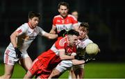 28 January 2017; Peter Hagan of Derry in action against Ronan O'Neill and Mark Bradley of Tyrone during the Bank of Ireland Dr. McKenna Cup Final match between Tyrone and Derry at Pairc Esler in Newry, Co. Down. Photo by Oliver McVeigh/Sportsfile
