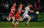 28 January 2017; Peter Harte of Tyrone in action against Conor McAtamney and Enda Lynn of Derry during the Bank of Ireland Dr. McKenna Cup Final match between Tyrone and Derry at Pairc Esler in Newry, Co. Down. Photo by Oliver McVeigh/Sportsfile