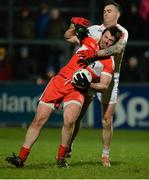 28 January 2017; Mark Lynch Derry in action against Cathal McCarron of Tyrone during the Bank of Ireland Dr. McKenna Cup Final match between Tyrone and Derry at Pairc Esler in Newry, Co. Down. Photo by Oliver McVeigh/Sportsfile