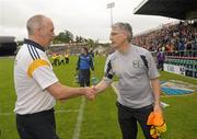 25 June 2011; Longford manager Glenn Ryan shakes hands with Cavan joint manager Val Andrews, right, after the game. GAA Football All-Ireland Senior Championship Qualifier Round 1, Cavan v Longford, Kingspan Breffni Park, Co. Cavan. Picture credit: Paul Mohan / SPORTSFILE