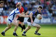 25 June 2011; Barry Grogan, Tipperary, in action against Cahir Healy, Laois. GAA Football All-Ireland Senior Championship Qualifier Round 1, Laois v Tipperary, O'Moore Park, Portlaoise, Co. Laois. Picture credit: Brendan Moran / SPORTSFILE