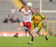 26 June 2011; Brian Dooher, Tyrone, in action against Anthony Thompson, Donegal. Ulster GAA Football Senior Championship Semi-Final, Tyrone v Donegal, St Tiernach's Park, Clones, Co. Monaghan. Picture credit: Oliver McVeigh / SPORTSFILE