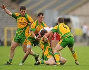 26 June 2011; Brian Dooher, Tyrone, in action against Donegal players, from left, Paddy McBrearty, Karl Lacey, Leo McLoone and Paddy McGrath. Ulster GAA Football Senior Championship Semi-Final, Tyrone v Donegal, St Tiernach's Park, Clones, Co. Monaghan. Picture credit: Oliver McVeigh / SPORTSFILE
