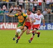 26 June 2011; Ryan Bradley , Donegal, in action against Brian Dooher and Davy Harte, right, Tyrone. Ulster GAA Football Senior Championship Semi-Final, Tyrone v Donegal, St Tiernach's Park, Clones, Co. Monaghan. Picture credit: Michael Cullen / SPORTSFILE