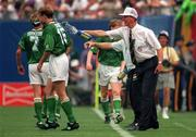18 June 1994; Republic of Ireland manager Jack Charlton splashes water on Tommy Coyne, 15, and Andy Townsend during the FIFA World Cup 1994 Group E match between Republic of Ireland and Italy at Giants Stadium in New Jersey, USA. Photo by Ray McManus/Sportsfile
