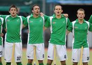 20 June 2011; Ireland players, from left, Shane O'Donoghue, Christopher Cargo, Tim Lewis and Stuart Loughrey stand for the national anthem before the game. UCD Men's 4 Nations Tournament, Ireland v China, UCD, Belfield, Dublin. Picture credit: Brendan Moran / SPORTSFILE
