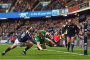 4 February 2017; Keith Earls of Ireland goes over to score his side's first try despite the tackle of Finn Russell of Scotland during the RBS Six Nations Rugby Championship match between Scotland and Ireland at BT Murrayfield Stadium in Edinburgh, Scotland. Photo by Ramsey Cardy/Sportsfile