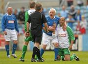 2 July 2011; Paul McGrath, Republic of Ireland XI, and Mick Cooke, League of Ireland Managers Selection, remonstrate with referee Pat Kelly during the game. Italia 90 World Cup Reunion Match, Republic of Ireland XI v League of Ireland Managers Selection, Hunky Dory Park, Drogheda, Co. Louth. Picture credit: Paul Mohan / SPORTSFILE
