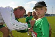 2 July 2011; Eoin Miller, age 3, from Lusk Co. Dublin, has his shirt signed by Ronnie Whelan after the game. Italia 90 World Cup Reunion Match, Republic of Ireland XI v League of Ireland Managers Selection, Hunky Dory Park, Drogheda, Co. Louth. Picture credit: Paul Mohan / SPORTSFILE