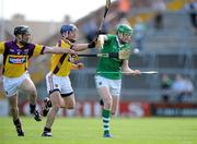 2 July 2011; Seamus Hickey, Limerick, in action against Darren Stamp, left, and Malachy Travers, Wexford. GAA Hurling All-Ireland Senior Championship, Phase 2, Limerick v Wexford, Gaelic Grounds, Limerick. Picture credit: Matt Browne / SPORTSFILE