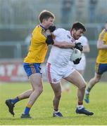 5 February 2017; Ronan O'Neill of Tyrone in action against Ronan Stack of Roscommon during the Allianz Football League Division 1 Round 1 match between Tyrone and Roscommon at Healy Park in Omagh, Co. Tyrone. Photo by Oliver McVeigh/Sportsfile