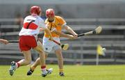 3 July 2011; Daniel McCloskey, Antrim, shoots to score his side's third goal of the game despite the attention of Ryan Farren, Derry. Ulster GAA Hurling Minor Championship Final, Antrim v Derry, Casement Park, Belfast, Co. Antrim. Picture credit: Pat Murphy / SPORTSFILE
