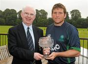 5 July 2011; Ireland's Gary Wilson receives a presentation from Dr. Murray Power, President of the Northern Cricket Union, to mark his 100th cap for Ireland. One Day International, Ireland v Namibia, Stormont, Belfast, Co. Antrim. Picture credit: Paul Mohan / SPORTSFILE