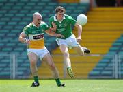 9 July 2011; Ian Ryan, Limerick, shoots to score his side's first goal despite the efforts of Scott Brady, Offaly. GAA Football All-Ireland Senior Championship Qualifier Round 2, Limerick v Offaly, Gaelic Grounds, Limerick. Picture credit: Diarmuid Greene / SPORTSFILE