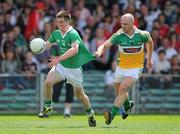 9 July 2011; Seamus O'Carroll, Limerick, in action against Scott Brady, Offaly. GAA Football All-Ireland Senior Championship Qualifier Round 2, Limerick v Offaly, Gaelic Grounds, Limerick. Picture credit: Stephen McCarthy / SPORTSFILE