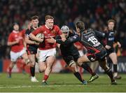10 February 2017; Rory Scannell of Munster is tackled by Ollie Griffiths and Carl Meyer, 15, of Newport Gwent Dragons during the Guinness PRO12 Round 14 match between Munster and Newport Gwent Dragons at Irish Independent Park in Cork. Photo by Eóin Noonan/Sportsfile