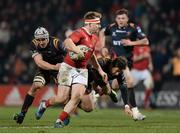 10 February 2017; Rory Scannell of Munster is tackled by Ollie Griffiths, left, and Carl Meyer, right, of Newport Gwent Dragons during the Guinness PRO12 Round 14 match between Munster and Newport Gwent Dragons at Irish Independent Park in Cork. Photo by Eóin Noonan/Sportsfile