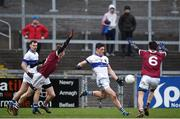 11 February 2017; Diarmuid Connolly of St Vincent's kicks a point for his team under pressure from Francis McEldowney, left, and Christopher McKaigue of Slaughtneil during the AIB GAA Football All-Ireland Senior Club Championship semi-final match between Slaughtneil and St Vincent's at Páirc Esler in Newry. Photo by Seb Daly/Sportsfile