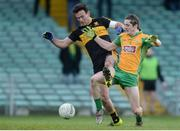 11 February 2017; Kieran Molloy of Corofin in action against Ambrose O'Donovan of Dr. Crokes during the AIB GAA Football All-Ireland Senior Club Championship semi-final match between Corofin and Dr. Crokes at Gaelic Grounds in Limerick. Photo by Eóin Noonan/Sportsfile