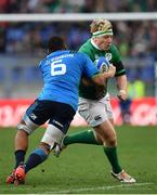 11 February 2017; James Tracy of Ireland is tackled by Maxime Mbanda of Italy during the RBS Six Nations Rugby Championship match between Italy and Ireland at the Stadio Olimpico in Rome, Italy. Photo by Ramsey Cardy/Sportsfile