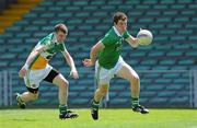 9 July 2011; Ian Ryan, Limerick, in action against Sean Pender, Offaly. GAA Football All-Ireland Senior Championship Qualifier Round 2, Limerick v Offaly, Gaelic Grounds, Limerick. Picture credit: Diarmuid Greene / SPORTSFILE
