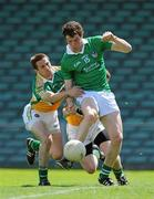 9 July 2011; Ian Ryan, Limerick, in action against Karol Slattery, left, and Sean Pender, Offaly. GAA Football All-Ireland Senior Championship Qualifier Round 2, Limerick v Offaly, Gaelic Grounds, Limerick. Picture credit: Diarmuid Greene / SPORTSFILE