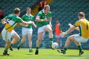 9 July 2011; Stephen Kelly, Limerick, in action against Brian Darby, left, and Alan Mulhall, Offaly. GAA Football All-Ireland Senior Championship Qualifier Round 2, Limerick v Offaly, Gaelic Grounds, Limerick. Picture credit: Diarmuid Greene / SPORTSFILE