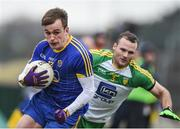 12 February 2017; Donie Smith of Roscommon in action against Neil McGee of Donegal during the Allianz Football League Division 1 Round 2 game between Roscommon and Donegal at Dr. Hyde Park in Roscommon. Photo by David Maher/Sportsfile