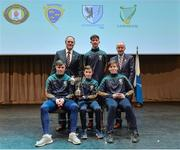 11 February 2017; The Donegal team, winners of the Tráth na gCeist, back row, centre, Ronan Gillespie, front row, from left, Anthony Molloy, Darragh Cunningham and Vincent Doherty, are presented with their medals and trophy by Antóin Mac Gabhann, Cathaoirleach Coiste Naisiúnta Scór, left, and Michael Hasson, Uachtarán Comhairle Uladh, at the Scór na nÓg Final 2017 at Waterfront Hotel in Belfast, Antrim. Photo by Piaras Ó Mídheach/Sportsfile