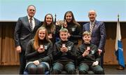 11 February 2017; The Moate All Whites team, representing Westmeath and Leinster, who won the Bailéad Ghrúpa competition, back row, Nicole Rabbitte, left, and Bronagh Bradley. Front row, from left, Edel Stone, Oisín Johnston and James Costello, are presented with their medals and trophy by Antóin Mac Gabhann, Cathaoirleach Coiste Naisiúnta Scór, left, and Michael Hasson, Uachtarán Comhairle Uladh, at the Scór na nÓg Final 2017 at Waterfront Hotel in Belfast, Antrim. Photo by Piaras Ó Mídheach/Sportsfile