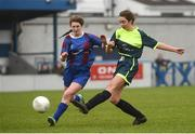 14 February 2017; Megan Nugent of Sacred Heart Westport has a shot on goal despite the efforts of Sarah Fitzgerald of Coláiste na Trócaire Rathkeale during the Bank of Ireland FAI Schools Senior Girls National Cup Final match between Sacred Heart School Westport and Coláiste na Trócaire Rathkeale at Home Farm FC in Whitehall, Dublin. Photo by Cody Glenn/Sportsfile