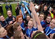 14 February 2017; Coláiste na Trócaire Rathkeale joint captain Eadaoin Lyons lifts the trophy with team-mates after their victory in the Bank of Ireland FAI Schools Senior Girls National Cup Final match between Sacred Heart School Westport and Coláiste na Trócaire Rathkeale at Home Farm FC in Whitehall, Dublin. Photo by Cody Glenn/Sportsfile