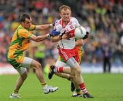 17 July 2011; Martin Donaghy, Derry, in action against Karl Lacey, Donegal. Ulster GAA Football Senior Championship Final, Derry v Donegal, St Tiernach's Park, Clones, Co. Monaghan. Picture credit: Brian Lawless / SPORTSFILE