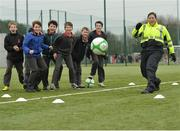 "16 February 2017; Garda Ruth Molloy, from the Raheny Station, shoots on goal during an FAI and Garda initiative, run with the cooperation of Dublin City Council, to promote the messages of ""Show Racism the Red Card,"" anti-bullying, and personal safety. The football blitz involving ten local schools, FAI Project Futsal Ballymun and the FAI Transition Year, took place at the Alfie Byrne Road All-Weather Pitch in Clontarf, Dublin. Photo by Cody Glenn/Sportsfile"