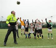 "16 February 2017; Sgt Jim Clavin, from the Clontarf Station, plays with footballers from Springdale National School Raheny, during an FAI and Garda initiative, run with the cooperation of Dublin City Council, to promote the messages of ""Show Racism the Red Card,"" anti-bullying, and personal safety. The football blitz involving ten local schools, FAI Project Futsal Ballymun and the FAI Transition Year, took place at the Alfie Byrne Road All-Weather Pitch in Clontarf, Dublin. Photo by Cody Glenn/Sportsfile"
