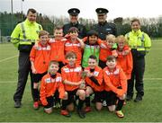 "16 February 2017; The champions from St Brigid's Boys National School Killester with, from left, Garda John Hanrahn, from the Clontarf Station, Inspector Jim McDermott, Chief Barry O'Brien, based in Ballymun Station, and Garda Caroline Maye, from the Clontarf Station, during an FAI and Garda initiative, run with the cooperation of Dublin City Council, to promote the messages of ""Show Racism the Red Card,"" anti-bullying, and personal safety. The football blitz involving ten local schools, FAI Project Futsal Ballymun and the FAI Transition Year, took place at the Alfie Byrne Road All-Weather Pitch in Clontarf, Dublin. Photo by Cody Glenn/Sportsfile"