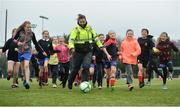 "16 February 2017; Garda Caroline Maye, from the Clontarf Station, plays with footballers fromBelgrove Senior Girls School Clontarf, during an FAI and Garda initiative, run with the cooperation of Dublin City Council, to promote the messages of ""Show Racism the Red Card,"" anti-bullying, and personal safety. The football blitz involving ten local schools, FAI Project Futsal Ballymun and the FAI Transition Year, took place at the Alfie Byrne Road All-Weather Pitch in Clontarf, Dublin. Photo by Cody Glenn/Sportsfile"