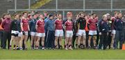 11 February 2017; The Slaughtneil squad with manager Mickey Moran, extreme left, stands for the anthem before the AIB GAA Football All-Ireland Senior Club Championship semi-final match between Slaughtneil and St Vincent's at Páirc Esler in Newry. Photo by Oliver McVeigh/Sportsfile