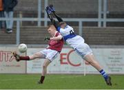 11 February 2017; Christopher Bradley of Slaughtneil scores a point despite the attempted block of Craig Wilson of St Vincent's during the AIB GAA Football All-Ireland Senior Club Championship semi-final match between Slaughtneil and St Vincent's at Páirc Esler in Newry. Photo by Oliver McVeigh/Sportsfile
