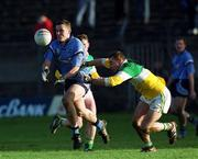23 Februa ry 2002; Ciaran Whelan, Dublin, in action against Adrian Mahon, Offaly. Allianz National Football League, Offaly v Dublin, O'Connor Park, Tullamore, Co. Offaly. Picture credit; Damien Eagers / SPORTSFILE