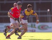 9 Macrh 2002; Adrian Fenlon, Wexford, in action against John Browne, Cork.  Cork v Wexford, National Hurling League, Pairc Ui Chaoimh, Cork. Picture credit; Brendan Moran / SPORTSFILE