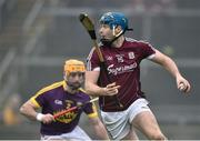 19 January 2017; Conor Cooney of Galway in action against Eoin Moore of Wexford during the Allianz Hurling League Division 1B Round 2 match between Galway and Wexford at Pearse Stadium in Galway. Photo by David Maher/Sportsfile