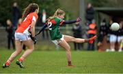 19 February 2017; Sarah Rowe of Mayo scoring a point despite the attention of Clodagh McCambridge of Armagh during the Lidl Ladies Football National League round 3 match between Armagh and Mayo at Clonmore in Armagh. Photo by Oliver McVeigh/Sportsfile
