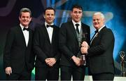 3 November 2017; Galway hurler Conor Cooney is presented with his PwC All Star award from Uachtarán Chumann Lúthchleas Gael Aogán Ó Fearghail, in the company of Feargal O'Rourke, left, Managing Partner, PwC, and David Collins, GPA President during the PwC All Stars 2017 at the Convention Centre in Dublin. Photo by Brendan Moran/Sportsfile
